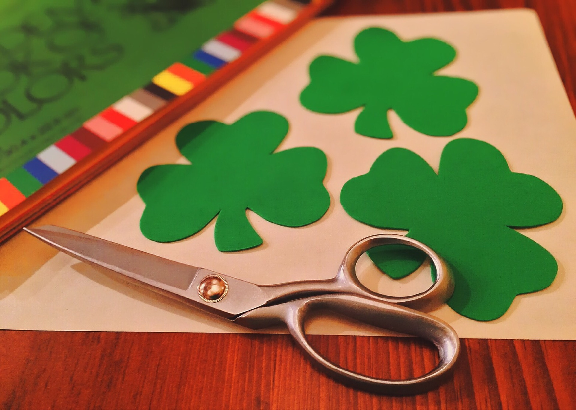 Family cutting together crafts at St Patricks festivities with events in Branson Missouri